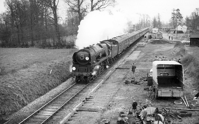 "Merchant Navy Class 4-6-2 ""30528 Clan Line"" just prior to station closure"